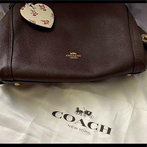 Deep burgundy colored Coach purse